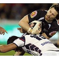 warrior_aidan_kirk_is_tackled_by_rooster_anthony_c_1741368325.jpg